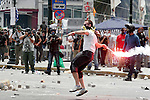 Greek police firing tear gas fought running battles with stone-throwing protesters outside parliament as signs grew the government would succeed in pushing through an austerity plan demanded by creditors.
