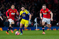 Sunday 05 January 2014<br /> Pictured:Alejandro Pozuelo runs forward with ball <br /> Re: Manchester Utd FC v Swansea City FA cup third round match at Old Trafford, Manchester