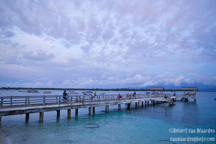 Locals enjoy the evening on a pier on the tourist island of Gili Trawangan, Lombok, Indonesia.