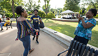 Guests mingle Friday, June 19, 2020, during a Juneteenth cookout at Lawrence Plaza in Bentonville. Go to nwaonline.com/200620Daily/ to see more photos.<br /> (NWA Democrat-Gazette/Ben Goff)