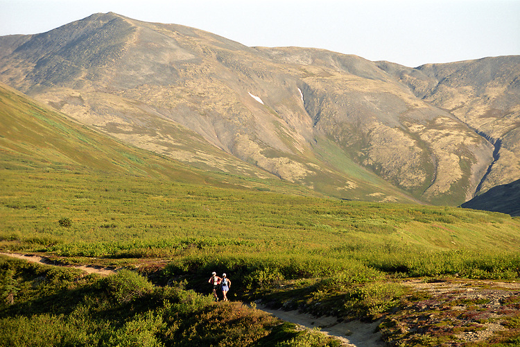 Karen WIlliams is paced by her friend Anne WIlliams near the 2,500-foot summit of Resurrection Pass in the Kenai Mountains, about 30 miles into the Resurrection Pass Trail 100-Miler ultramarathon foot race in August 2004. The course requires runners to climb - and descend - about a mile of vertical elevation through the Chugach National Forest between Cooper Landing and Hope, Alaska.