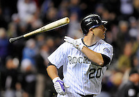 14 April 2010: Colorado Rockies catcher Chris Iannetta (20) lets his bat fly as he celebrates after hitting a homerun leading off the bottom of the 10th inning to end a regular season Major League Baseball game between the Colorado Rockies and the New York Mets at Coors Field in Denver,  Colorado. The Rockies defeated the Mets 6-5 in 10 innings.  *****For Editorial Use Only*****