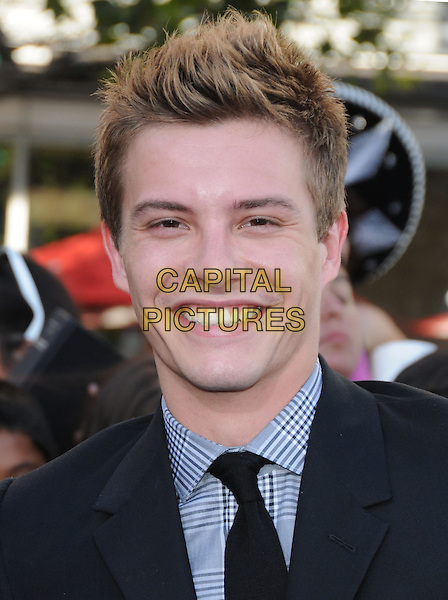 XAVIER SAMUEL.The premiere of The Twilight Saga : Eclipse held at the Los Angeles Film Festival at Nokia Live in Los Angeles, California, USA..June 24th, 2010    .headshot portrait grey gray check black .CAP/RKE/DVS.©DVS/RockinExposures/Capital Pictures.