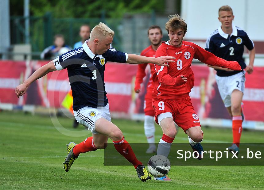Scotland U19 - Georgia U19 : duel between Jack Grimmer (3) and Teimurazi Markozashvili (9).foto DAVID CATRY / Nikonpro.be