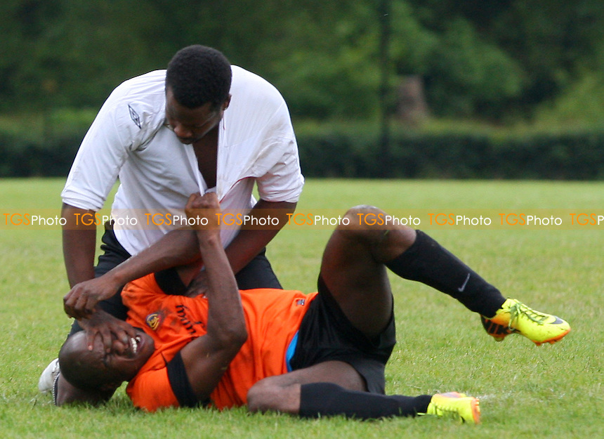 The incident which saw a Mile End player sent off for punching and a Mustard player sent off for biting - Mustard (orange) vs Mile End (white) - Hackney & Leyton Sunday League Jack Walpole Cup Final Football at South Marsh, Hackney Marshes, London - on 31/05/15 - MANDATORY CREDIT: Dave Simpson/TGSPHOTO - Self billing applies where appropriate - 0845 094 6026 - contact@tgsphoto.co.uk - NO UNPAID USE