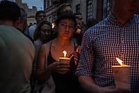 NEW YORK JUNE 13: People holding candles  in solidarity for the victims outside Manhattan's historic Stonewall Inn to express their support for the victims killed at Pulse nightclub in Orlando. New York June 13, 2016<br /> Photo by VIEWpress/Maite H. Mateo.