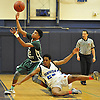 Camren Wynter #12 of Holy Trinity, left, tries to corral a loose ball during a varsity boys' basketball game against Hempstead at Baldwin High School on Tuesday, Dec. 29, 2015. Holy Trinity won by a score of 70-58.