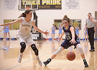 NWA Democrat-Gazette/BEN GOFF @NWABENGOFF<br /> Lauren Hargus (left) of Bentonville guards Jacie Higgins of Springdale Har-Ber on Friday Jan. 15, 2016 during the game in Bentonville's Tiger Arena.