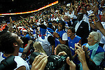 French national basketball team players Noah Joakim and his father Jannick Noah celebrate victory with their fans and supporters after semifinal basketball game between France and Russia in Kaunas, Lithuania, Eurobasket 2011, Friday, September 16, 2011. (photo: Pedja Milosavljevic)