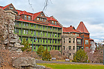 MARCH 13, 2011 - NEW PALTZ: Mohonk Mountain House front section with green balconies, red roof, stone structures with bare vines in winter, in New Paltz, New York, USA. National historic landmark and world famous tourist destination built and run by Quaker Smiley family since 1869.