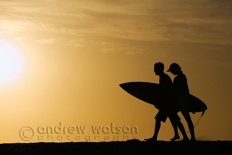 Surfers at sunset.  Margaret River, Western Australia, AUSTRALIA.