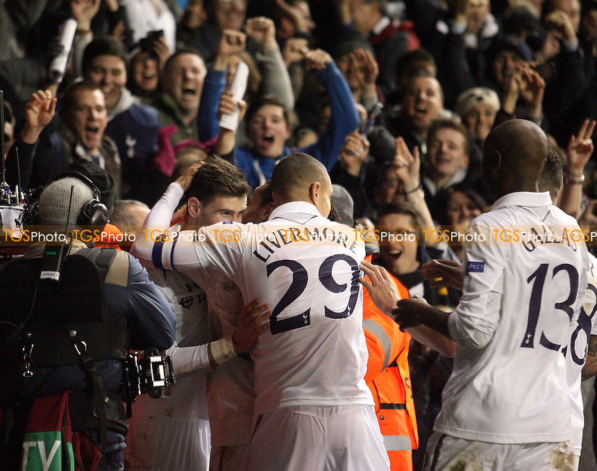 Gareth Bale of Tottenham Hotspur is congratulated after scoring the second goal - Tottenham Hotspur vs  Olympique Lyonnais at the White Hart Lane Stadium - 14/02/13 - MANDATORY CREDIT: Dave Simpson/TGSPHOTO - Self billing applies where appropriate - 0845 094 6026 - contact@tgsphoto.co.uk - NO UNPAID USE.