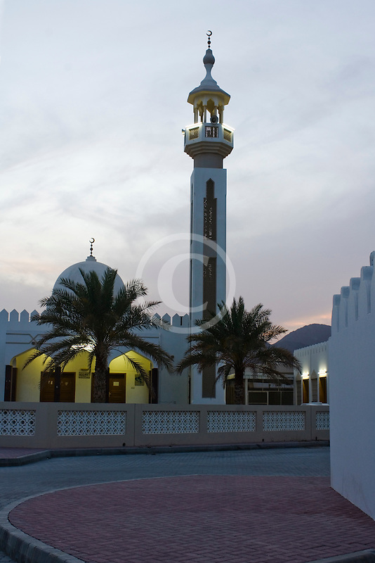 United Arab Emirates, Sharjah, Community mosque and minaret at dusk
