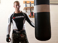 Staff Sgt. Robin Johnson, 29 of Boston, Mass., was a squad leader for the Scout Platoon attached to Charlie 1-26 INF. Home in Schweinfurt, Germany, Johnson practices mixed martial arts to help him cope with the loss of friends and the horror experienced in Adhamiyah, Iraq...Soldiers from Charlie Company, 1-26 Infantry took some of the greatest losses during their 15th month deployment to East Baghdad in 2006-2007. The company alone lost 14 soldiers. Returning from combat to their home in Schweinfurt, Germany, the men of Charlie Company struggle to heal from their physical and emotional wounds. (James J. Lee / Military Times)