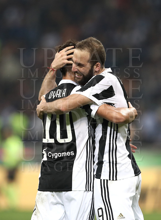 Calcio, Serie A: Inter - Juventus, Milano, stadio Giuseppe Meazza (San Siro), 28 aprile 2018.<br /> Juventus' Gonzalo Higuain (r) celebrates after scoring with his teammate Paulo Dybala (l) during the Italian Serie A football match between Inter Milan and Juventus at Giuseppe Meazza (San Siro) stadium, April 28, 2018.<br /> UPDATE IMAGES PRESS/Isabella Bonotto