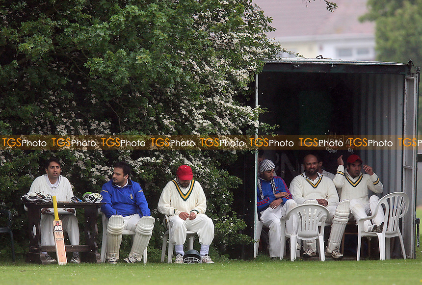 West Essex players shelter from the rain - Harold Wood CC 3rd XI vs West Essex CC 3rd XI - Essex Cricket League - 29/05/10 - MANDATORY CREDIT: Gavin Ellis/TGSPHOTO - Self billing applies where appropriate - Tel: 0845 094 6026