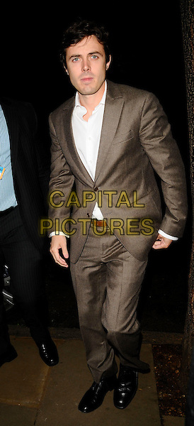 "CASEY AFFLECK.Attending ""The Return of The Salon"" Party at the Sanderson Hotel, London, England, UK, May 28th 2008..full length brown suit white shirt belt.CAP/CAN.©Can Nguyen/Capital Pictures"