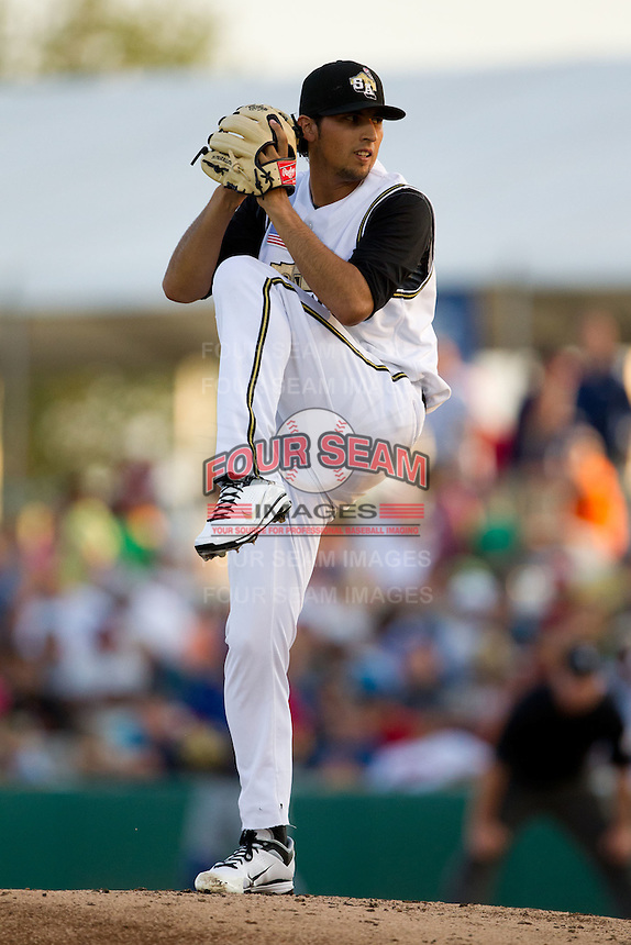 Jorge Reyes (7) of the San Antonio Missions winds up during a game against the North All-Stars 2011 in the Texas League All-Star game at Nelson Wolff Stadium on June 29, 2011 in San Antonio, Texas. (David Welker / Four Seam Images)..