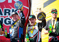Oct 14, 2019; Concord, NC, USA; NHRA funny car driver Robert Hight (left) and top fuel driver Steve Torrence celebrate after winning the Carolina Nationals at zMax Dragway. Mandatory Credit: Mark J. Rebilas-USA TODAY Sports