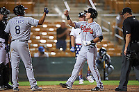 Salt River Rafters Dylan Moore (5), of the Atlanta Braves organization, is congratulated by Noel Cuevas (8), of the Colorado Rockies organization, after hitting a home run during a game against the Glendale Desert Dogs on October 19, 2016 at Camelback Ranch in Glendale, Arizona.  Salt River defeated Glendale 4-2.  (Mike Janes/Four Seam Images)