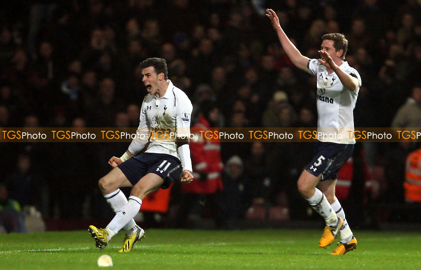 Gareth Bale celebrates after scoring the 3rd goal for Spurs - West Ham United vs Tottenham Hotspur, Barclays Premier League at Upton Park, West Ham - 25/02/13 - MANDATORY CREDIT: Rob Newell/TGSPHOTO - Self billing applies where appropriate - 0845 094 6026 - contact@tgsphoto.co.uk - NO UNPAID USE.