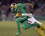 (Boston, MA, 11/21/15) Notre Dame's Amir Carlisle, left, is tackled by Boston College's William Harris during the fourth quarter as Notre Dame hosts Boston College at Fenway Park in Boston on Saturday, November 21, 2015. Photo by Christopher Evans