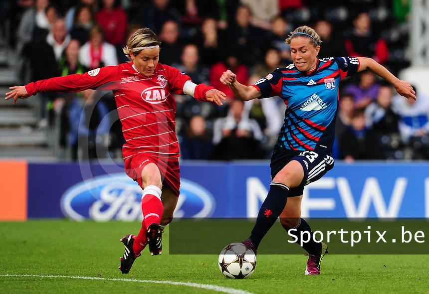 Uefa Women 's Champions League Final 2011 at Craven Cottage Fulham - London : Olympique Lyon - Turbine Potsdam : duel tussen Jennifer Zietz (c) en Camille Abily..foto DAVID CATRY / JOKE VUYLSTEKE / Vrouwenteam.be.