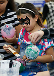 Gissel Anguiano, 8, creates a paper m&acirc;ch&eacute; ornament during the La Posada Celebration at Western Nevada College, in Carson City, Nev., on Saturday, Dec. 15, 2018. <br /> Photo by Cathleen Allison/Nevada Momentum