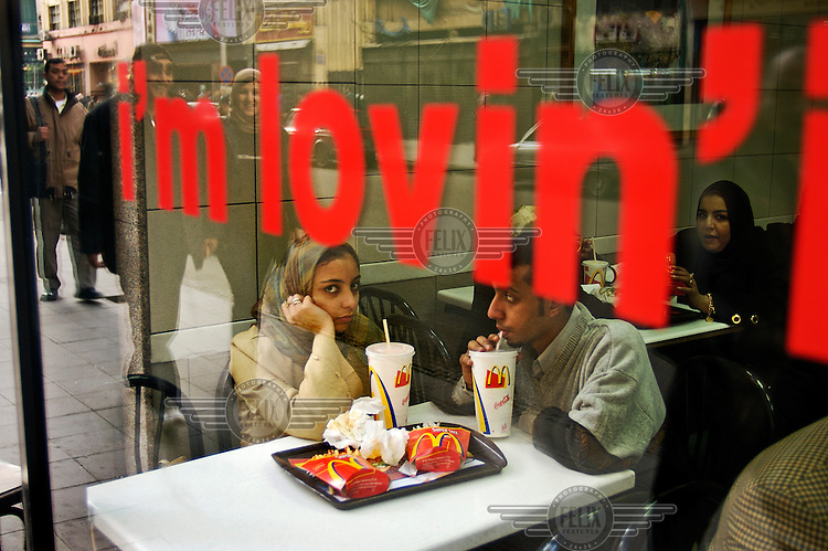 Young couple in a downtown McDonald's.