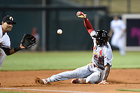 Peoria Javelinas outfielder C.J. McElroy (27) slides safely into third during an Arizona Fall League game against the Glendale Desert Dogs on October 13, 2014 at Camelback Ranch in Phoenix, Arizona.  The game ended in a tie, 2-2.  (Mike Janes/Four Seam Images)