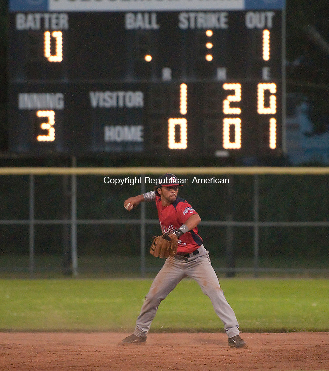TORRINGTON, CT 082014JS16--Wolcott's Manny Cruz throws to first for the out after fielding a ground ball during game 1 of their Tri-State League finals against Tri-Town Wednesday at Fuessenich Park in Torrington. <br /> Jim Shannon Republican-American