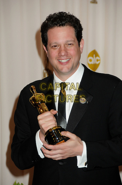 MICHAEL GIACCHINO.82nd Annual Academy Awards held at the Kodak Theatre, Hollywood, California, USA..March 7th, 2010.oscars half length black suit award trophy winner .CAP/ADM/BP.©Byron Purvis/AdMedia/Capital Pictures.