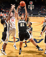 Feb. 3, 2011; Charlottesville, VA, USA; Wake Forest Demon Deacons forward Sandra Garcia (21) grabs a rebound next to Virginia Cavaliers forward Chelsea Shine (50) and Wake Forest Demon Deacons guard Lakevia Boykin (22) during the game at the John Paul Jones Arena. Virginia won 73-46. Mandatory Credit: Andrew Shurtleff