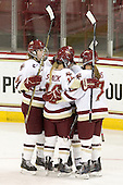 Taylor Wasylk (BC - 9), Kelli Stack (BC - 16) and Dru Burns (BC - 7) celebrate Stack's second goal of the game which stood as the game-winner. - The Boston College Eagles defeated the visiting Northeastern University Huskies 2-1 on Sunday, January 30, 2011, at Conte Forum in Chestnut Hill, Massachusetts.