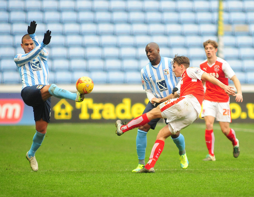 Fleetwood Town's Eggert Jonsson clears under pressure from Coventry City's Marcus Tudgay, left and Coventry City&rsquo;s Marc-Antoine Fortune, right<br /> <br /> Photographer Andrew Vaughan/CameraSport<br /> <br /> Football - The Football League Sky Bet League One - Coventry City v Fleetwood Town - Saturday 27th February 2016 - Ricoh Stadium - Coventry   <br /> <br /> &copy; CameraSport - 43 Linden Ave. Countesthorpe. Leicester. England. LE8 5PG - Tel: +44 (0) 116 277 4147 - admin@camerasport.com - www.camerasport.com