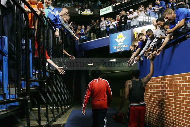 John Wall high fives fans as he leaves the court during a NBA Preseason game between the Washington Wizards and the New Orleans Pelicans at Rupp Arena in Lexington, Ky., on Saturday, October 19, 2013. Photo by Michael Reaves | Staff