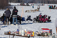 Scott Janssen passes picnicing spectators on Long Lake during the Restart of the 2016 Iditarod in Willow, Alaska.  March 06, 2016.