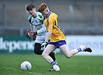 Shane Meehan of  Clare scores a goal despite Limerick's Kevin Walsh, late in the first half  during their Munster Minor football quarter final at  Cusack Park. Photograph by John Kelly.