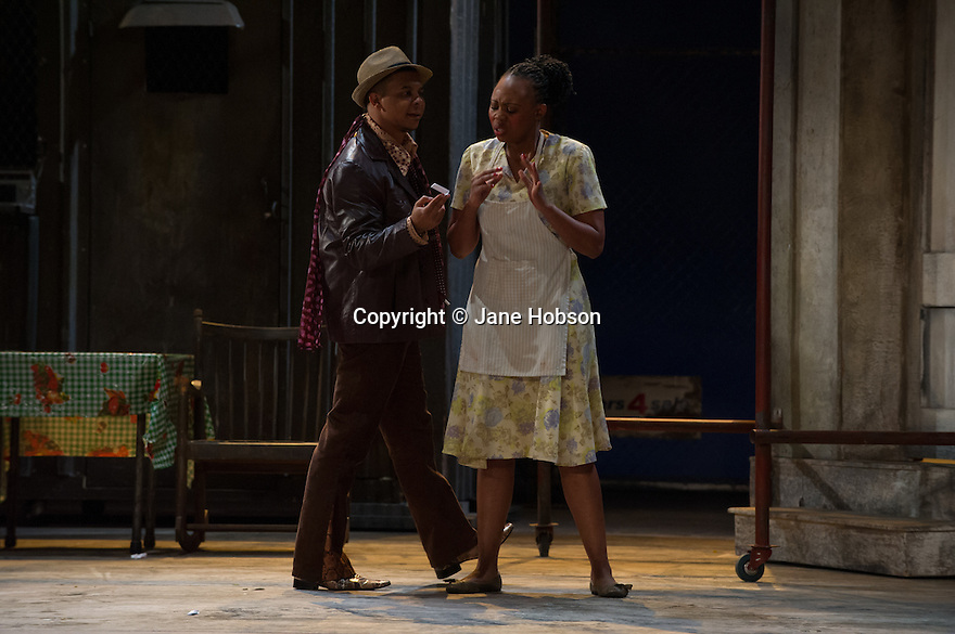 London, UK. 10.07.2012. Cape Town Opera returns to the London Coliseum with their acclaimed production of Porgy and Bess. Picture shows:  Victor Ryan Robertson (Sporting Life) and Nonhlanhla Yende (Bess). Photo credit: Jane Hobson