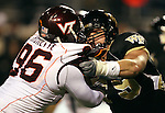 18 November 2006: Wake Forest's Steve Vallos (r) blocks Virginia Tech's Noland Burchette (l). The Virginia Tech Hokies defeated the Wake Forest University Demon Deacons 27-6 at Groves Stadium in Winston-Salem, North Carolina in an Atlantic Coast Conference NCAA Division I College Football game.