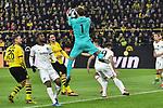 14.02.2020, Signal Iduna Park, Dortmund, GER, 1. BL, Borussia Dortmund vs Eintracht Frankfurt, DFL regulations prohibit any use of photographs as image sequences and/or quasi-video<br /> <br /> im Bild / picture shows / Kevin Trapp (#1, Eintracht Frankfurt) pariert den Ball vor den herannahenden Lukasz Piszczek (#26, Borussia Dortmund) Mats Hummels (#15, Borussia Dortmund) <br /> <br /> Foto © nordphoto/Mauelshagen