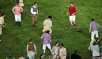 "27 JUL 2012 - LONDON, GBR - Actors play football during the ""Green and Pleasant Land"" section of the Opening Ceremony of the London 2012 Olympic Games in the Olympic Stadium in the Olympic Park, Stratford, London, Great Britain (PHOTO (C) 2012 NIGEL FARROW)"