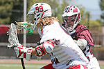 Orange, CA 05/01/10 - Connor Martin (Chapman # 99) and Greg Sharron (LMU # 18) in action during the LMU-Chapman MCLA SLC semi-final game in Wilson Field at Chapman University.  Chapman advanced to the final by defeating LMU 19-10.