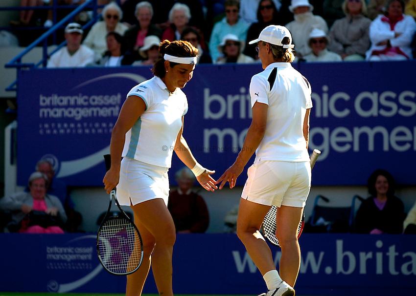 Photo. Rene Solari..22/6/01  .Eastbourne Day 5 (Semi-Finals).  Martina Navratilova partnering Arantxa Sanchez-Vicario look disappointed as they lose to  Lisa Raymond and Rennae Stubbs...
