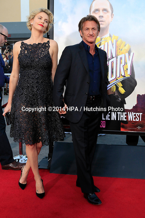 "LOS ANGELES - MAY 15:  Charlize Theron, Sean Penn at the ""A Million Ways To Die In The West"" World Premiere at Village Theater on May 15, 2014 in Westwood, CA"
