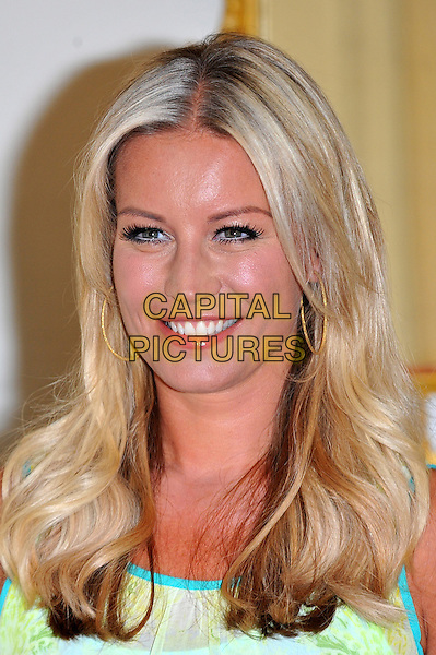 Denise Van Outen.launches the search for Tesco Mum of the Year at The Savoy London, England..September 5th, 2012.headshot portrait blue yellow  .CAP/CJ.©Chris Joseph/Capital Pictures.