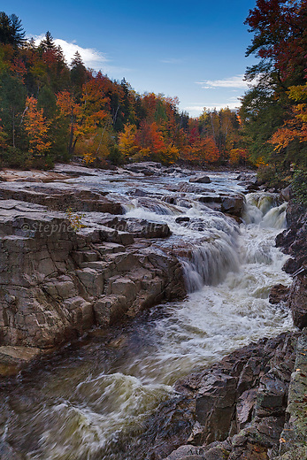 Water rushes powerfully through Rocky Gorge along the scenic Kancamagus Highway in Albany, New Hampshire.