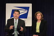 September 15, 2011 (Washington, DC)  Postmaster General Patrick Donahoe (left), and U.S. Postal Service CEO Megan J. Brennan (right), held a press conference announcing proposed comprehensive changes to the nationwide infrastructure.  Nearly 250 facilities face closure or consolidation, and workforce reductions may affect 35,000 positions.  Service standard revisions for First-Class Mail could also be likely, which would mean delivery of 2-3 days instead of the current 1-3 day window.  (Photo by Don Baxter/Media Images International)