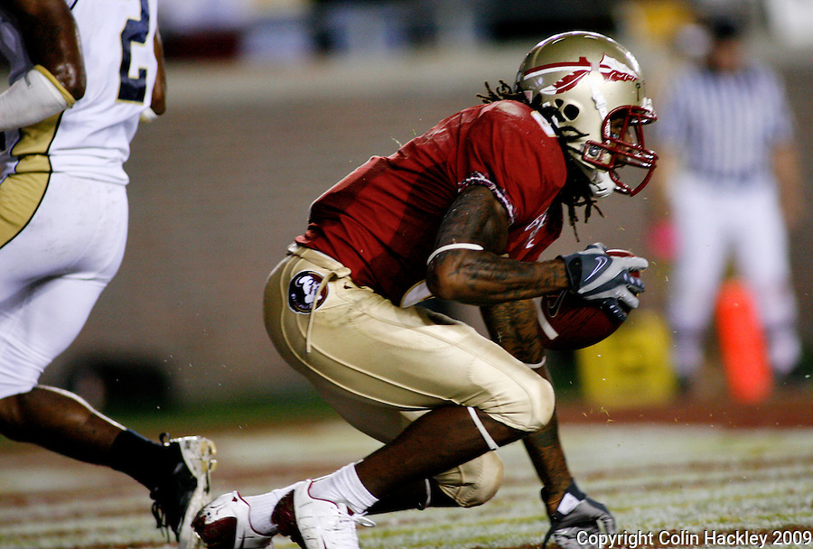 TALLAHASSEE, FL 10/10/09-FSU-Ga. Tech FB09 CH22-Florida State's Richard Goodman comes up with a pass for the Seminole's third touchdown against Georgia Tech during first half action Saturday at Doak Campbell Stadium in Tallahassee. .COLIN HACKLEY PHOTO