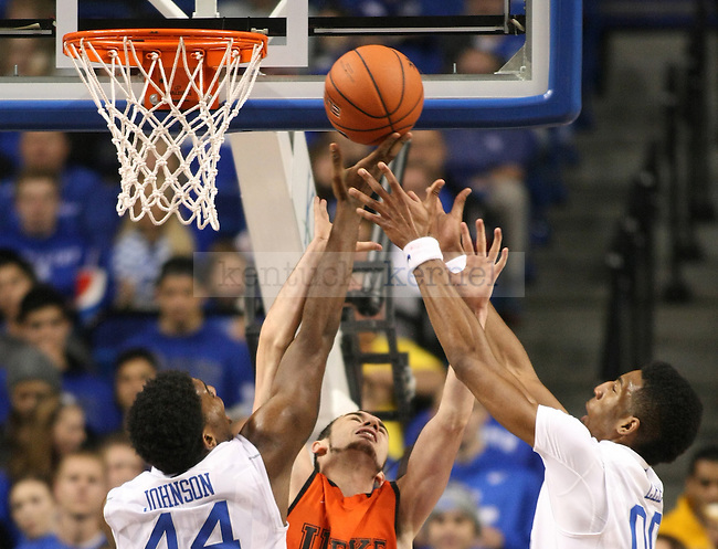 University of Kentucky sophomore center Dakari Johnson (44), left, and sophomore forward Marcus Lee (00) jump to grab a rebound ball against University of Pikeville junior forward Colt Chapman (12) during the second half of the UK men's exhibition basketball game vs. the University of Pikeville at Rupp Arena in Lexington, Ky., on Sunday, November 2, 2014. UK won 116-68. Photo by Tessa Lighty | Staff
